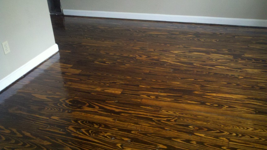 A refinished wood floor with a beautiful shine