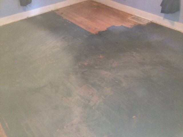 a before shot of one of our renewal projects showing a severely damaged hardwood floor
