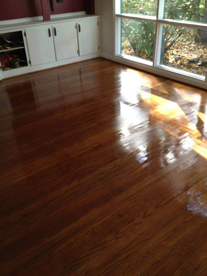 a freshly refinished hardwood floor looking as shiny as ever
