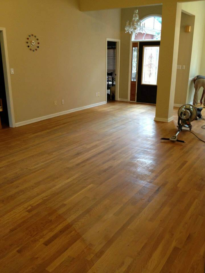 a lightly scratched and damaged hardwood floor surface.