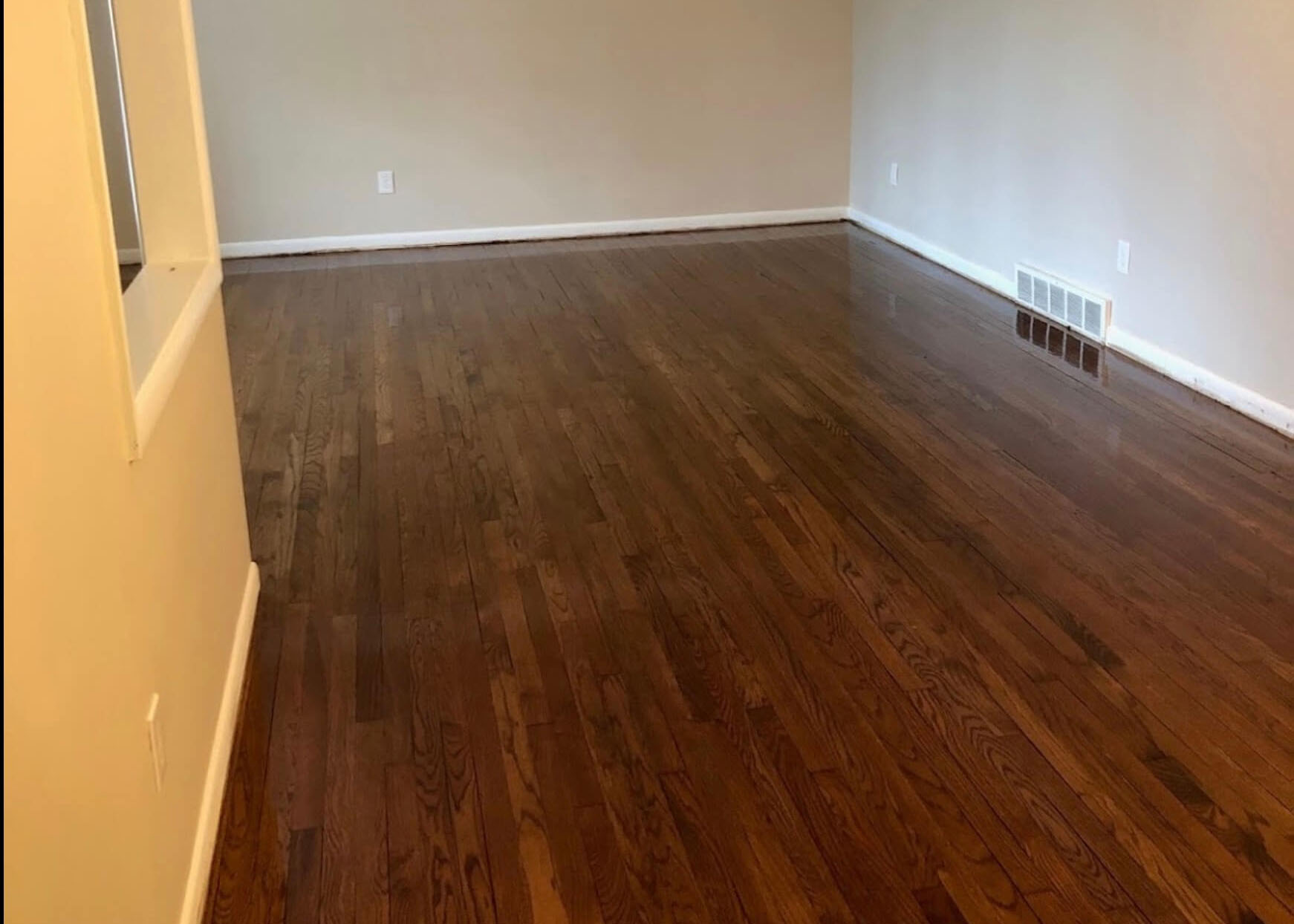 A finished hardwood floor refinishing project