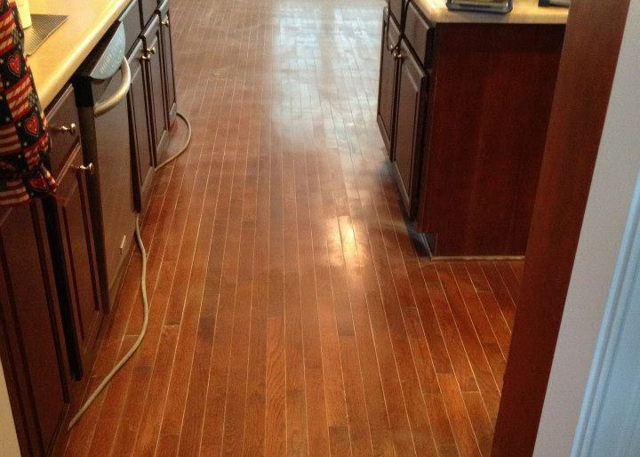A wood floor in need of being resurfaced