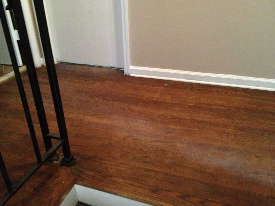 A hardwood floor before being refinished